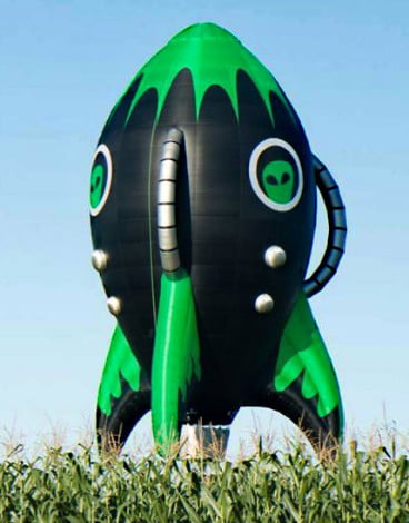 Green and black rocket ship balloon shape